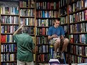 A man reads in a bookstore.