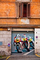 Racing motorcycles painted on a garage door in Rome