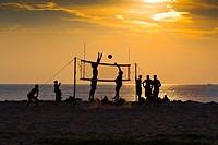 Playing Volleyball on Karon Beach at Sunset, Phuket, Thailand.