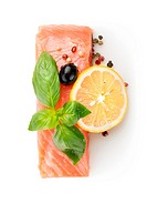 Fillet of salmon with lemon, olive and spices.