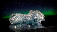 Ice with the Aurora Borealis. Ice formations come from the Jokulsarlon Glacial Lagoon, Breidamerkurjokull Glacier, Vatnajokull Ice Cap, Iceland.