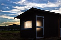 Dusk light and shed, Yufuin, Oita, Japan.