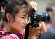 North Korean Guide Taking Pictures, Kaesong, North Korea.