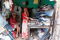 Old couple in a laundry, old woman ironing. Rajasthan, India