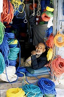Colorful rope seller in market Sanaa, Yemen