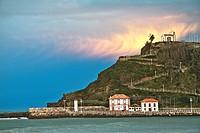 Ribadesella harbor entance and La Virgen de la Guia hermitage, Asturias, Spain.