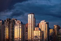 skyline condo towers at sunset on the north shore of False Creek, Vancouver, BC, Canada.