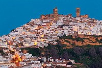 The White Town of Arcos de la Frontera on a limestone rock at dawn. Arcos de la Frontera, Cádiz province, Andalusia, Spain.