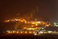 The White Town of Zahara de la Sierra below its Moorish castle at night. Cádiz province, Andalusia, Spain.