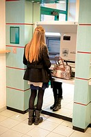 Student Withdrawing Money from BTM Machine in Bank Aix-en-Provence France.