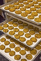 Gluten-free cookies arrayed on baking trays.