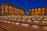 Linoln Center of the Performing Arts and the David H. Koch Theatre at twilight with the moon rising in New York City, USA