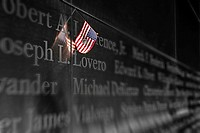 An American Flag is left as a symbol of remembrance at the Empty Sky Memorial at Liberty State Park in New Jersey.