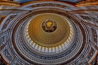 An interior view to the rotunda of the US Capitol. The rotunda is located below the Capitol dome. It´s neoclassical architecture style makes the rotun...