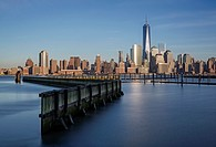 New York City Financial District skyline with One World Trade Center commonly referred to as The Freedom Tower. As seen from across the Hudson River i...