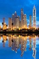 Night skyline of high-rise apartment and office towers in new Dubai Marina district in United Arab Emirates.