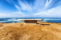 Sunset Cliffs Natural Park. San Diego, California, United States. Public bench at overlook point above the ocean.