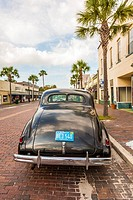 Antique car parked on street in historic Green Cove Springs, Florida.