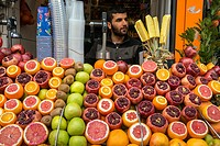 Fresh fruit juice vendor on a street in Galata, Beyoglu, Istanbul, Turkey.