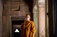 Monk in Temples of Bayon. Angkor site. Cambodia.