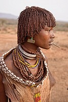 Hamer girl in her village near Turmi in the Omo Valley, Ethiopia.