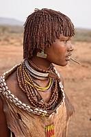 Hamer girl in her village near Turmi in the Omo Valley, Ethiopia.