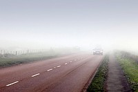 Car driven in fog on a country road, England, UK.