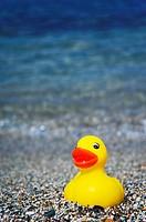Rubber duck on Aegean beach.