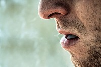 Detail of smoker male face smoking.