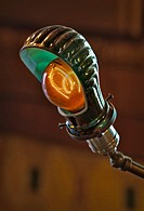 Thomas Edison carbon filament light bulb replica in a bankers desk style lamp.