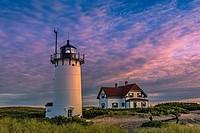 Race Point Lighthouse during sunset. Race Point is a historic lighthouse and it is located in the northern tip of Cape Cod, Massachusetts.