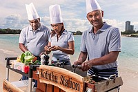 Asian catering chefs at the beach cooking with a Koththu station. Gold Coast, Queensland, Australia.