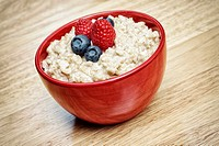 Bowl of Oatmeal Porridge, Hot Cereal with Berries, Fruits.