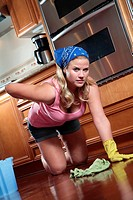 A young woman hurt mopping floor.