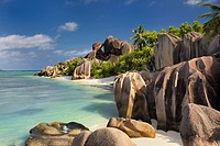 Famous beach Anse Source d´Argent with palm trees and sculpted rocks, La Digue Island, Seychelles, Indian Ocean.