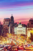 """Metropolis building seen from """"""""Puerta de Alcala"""""""" monument by sunset. Madrid, Spain."""