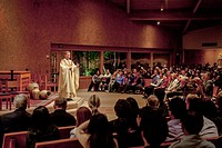 A pastor preaches a sermon to his congregation while conducting mass at St. Timothy´s Catholic Church, Laguna Niguel, CA.