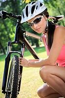 cycling woman taking a break in the park.