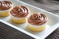 A row of chocolate cupcakes.