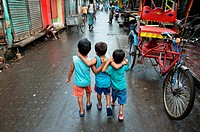 Children walking on the street in Kolkata.