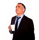 Portrait of a reflective business man with a white mug on isolated background.