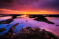 Sunset over the royal fishponds at Hapaiali´i Heiau, Kona Coast, The Big Island, Hawaii USA.