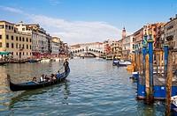 Gondola on the Grand Canal and Rialto Bridge. Venice, Veneto region, Italy, Europe.