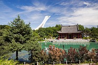 The Friendship Hall pavilion and the Dream Lake in summer at the Chinese Garden. The Olympic Stadium Tower is visible in the background. Montreal Bota...
