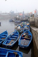 Essaouira fishing harbour in the morning with fog, Morocco, Africa.