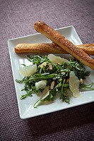 arugula salad with parmesan and fresh breadsticks.