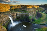 Palouse Falls plunging over layered basalt flows of the Columbia Plateau Washington.