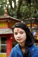 Portrait of a teenage girl with a Hindu tilaka marking at Tiger Hill.