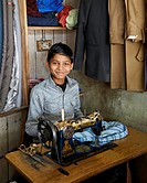 A young boy working as a tailor in Darjeeling.