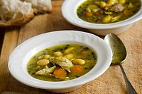 Herby chicken and butter bean soup.